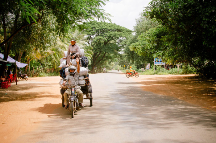 man and his motorcycle in Cambodia taken by Milie Del