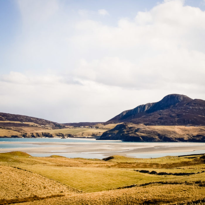 blue sea and green fields in Kyle of Tongue, North of Scotland taken by Milie Del