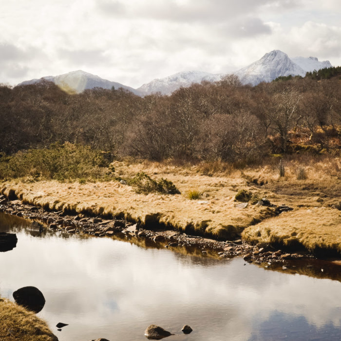 snow capped peaks and river at Kyle of Tongue, North of Scotland taken by Milie Del