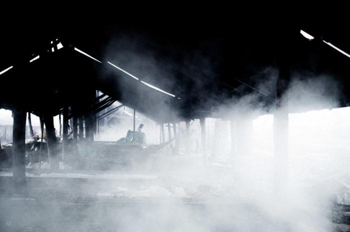 Salt of the earth girl silhouette in a salt factory under the rain near Vietiane Laos taken by Milie Del