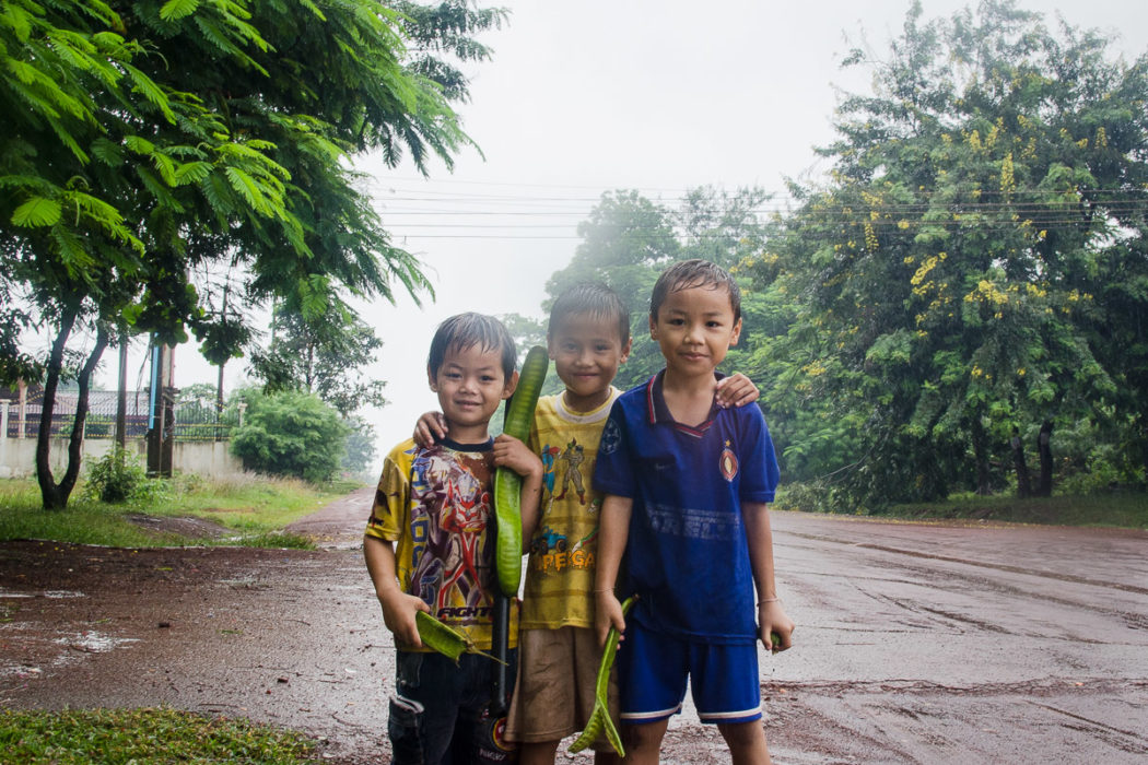 Portrait of Kids playing in a salt factory under the rain near Vientiane Laos taken by Milie Del