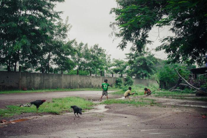 Landscape Kids playing in a salt factory under the rain near Vientiane Laos taken by Milie Del