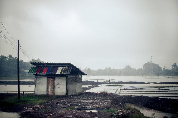 Landscape of a salt factory under the rain near Vientiane Laos taken by Milie Del