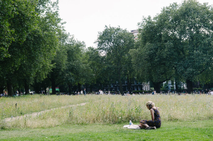 Girl reading in Victoria park, London taken by Milie Del