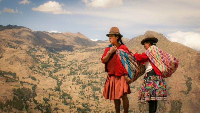 Andes women taking a pause in the mountains in the amary community in Peru taken by Milie Del