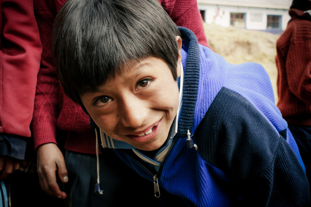 Portrait of a boy outside the school in the amary community in Peru taken by Milie Del