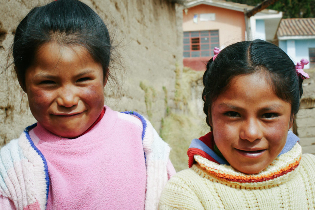 Portrait of two girls outside the school in the amary community in Peru taken by Milie Del