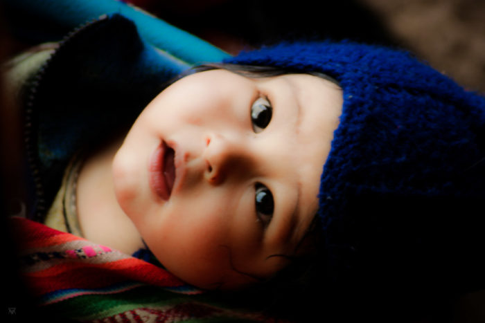 Baby portrait in the amary community in Peru taken by Milie Del
