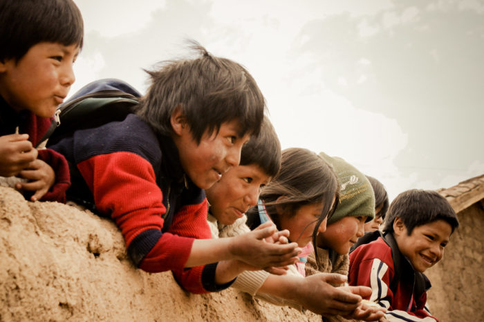 Children playing outside the school in the amary community in Peru taken by Milie Del