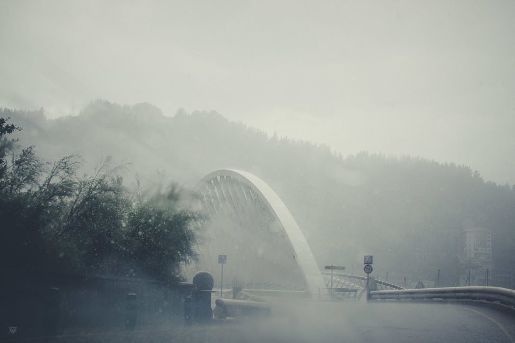 Photography of shadows on the road in the Basque Countru Spain heavy rain under the storm taken by Milie Del