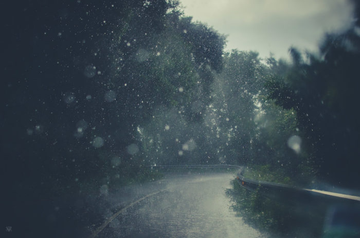 Photography drops of water on the road in the Basque Countru Spain heavy rain under the storm taken by Milie Del