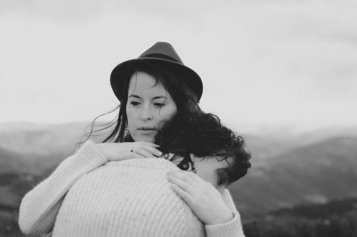 black and white Portrait of two girls hugging - our wildest dreams