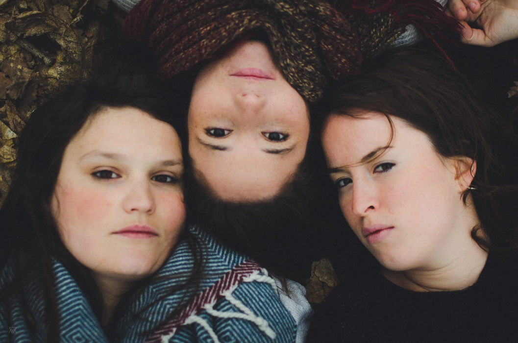 Our wildest Dreams Portrait of 3 girls laying on the ground taken by Milie Del