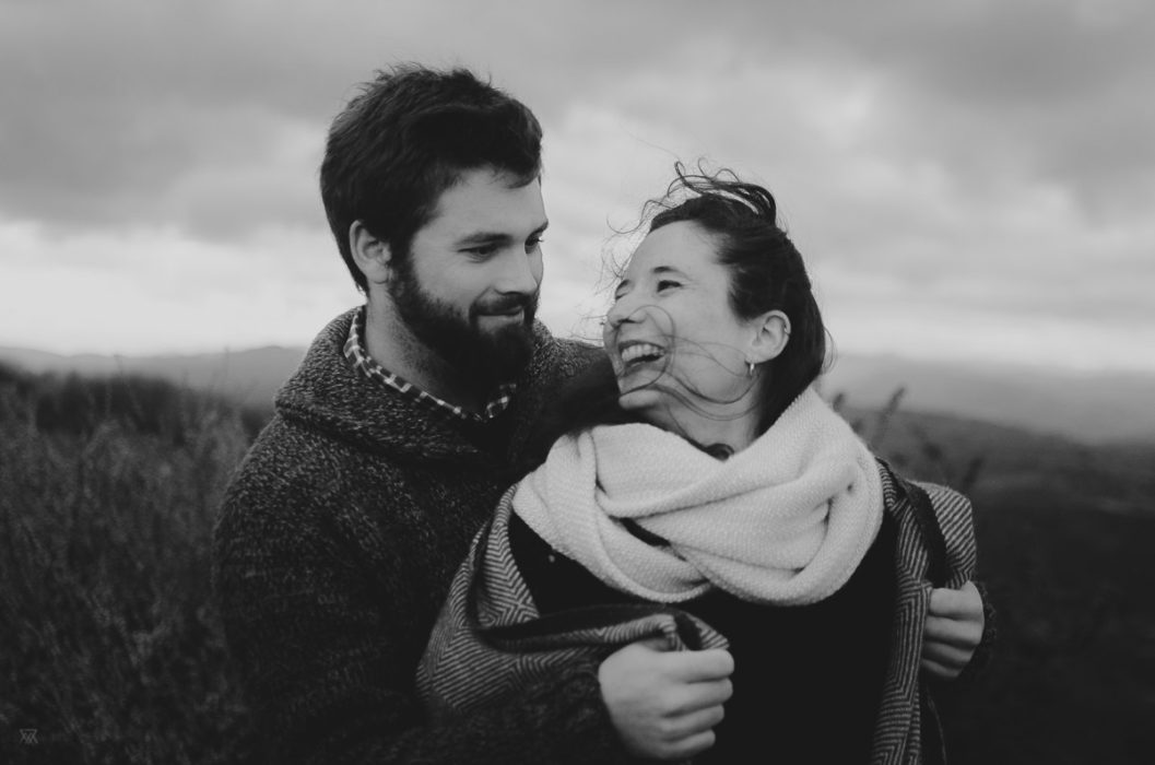 Black and white portrait of a couple smilling in the wilderness