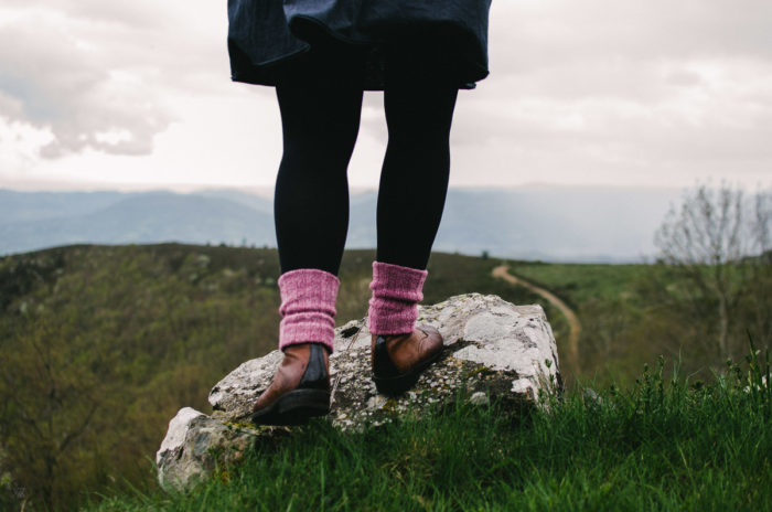 Foot standing on a rock following a path - our wildest dreams