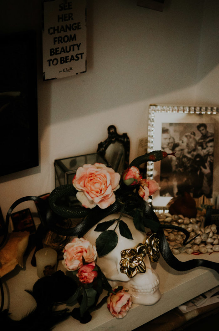 Roses frame skull apartment before editorial shoot