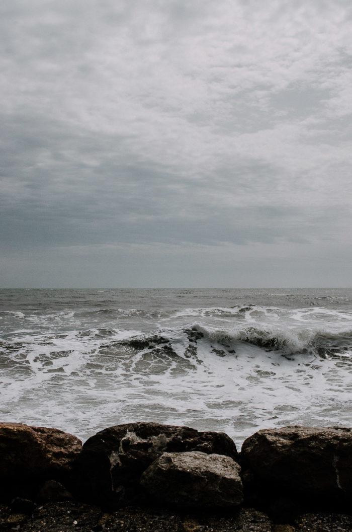 mediterranean sea's waves and foam on a cloudy day in les saintes marie de la mer