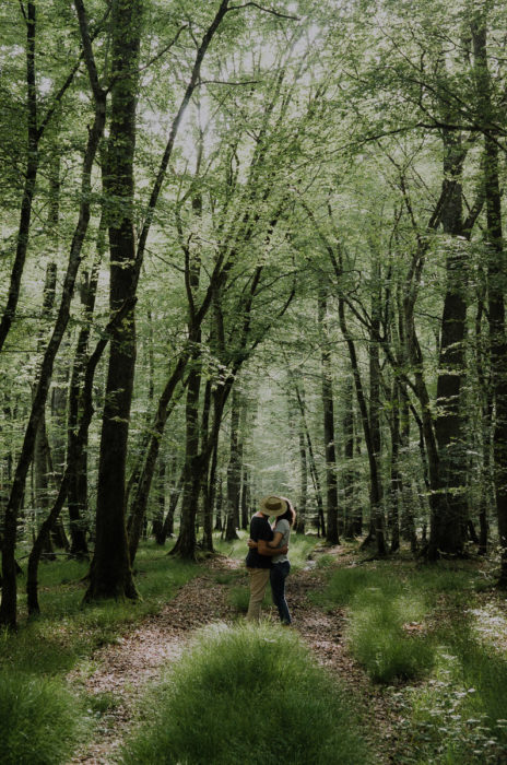 Couple kissing in a forest berry france