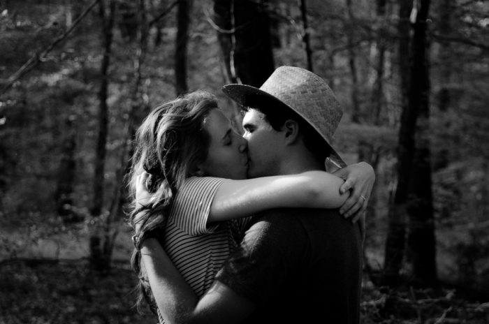 black white photo couple kissing forest lifestyle session