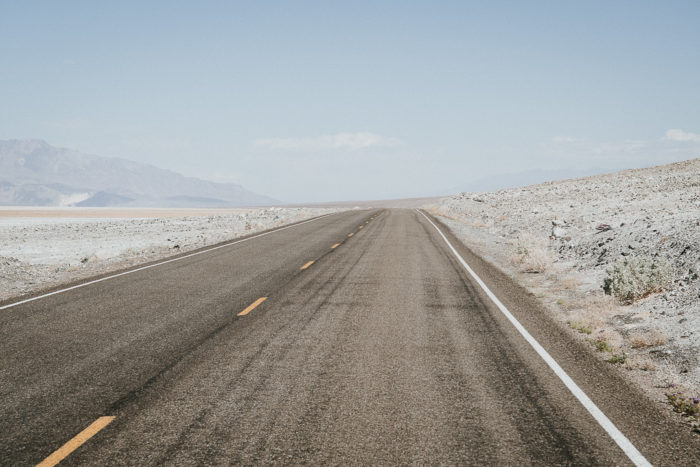 Desert road in Death Valley National Park in California by Milie Del photographer
