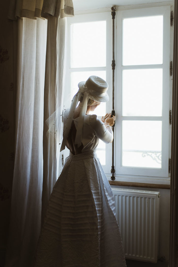 bride closing the window soft light