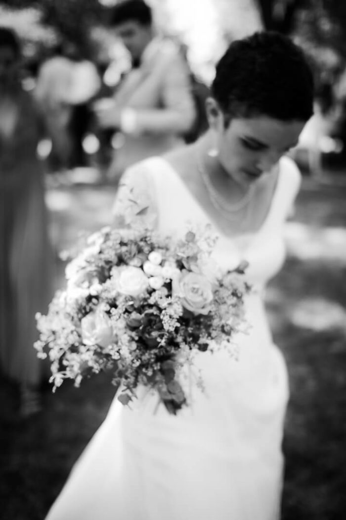 Black and white bride walking toward the outdoor ceremony