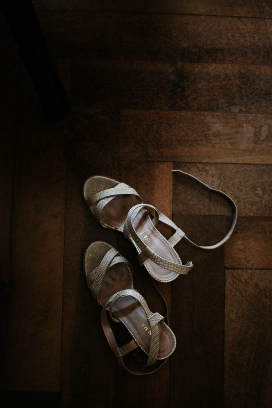 golden wedding shoes wooden floor bridal prep