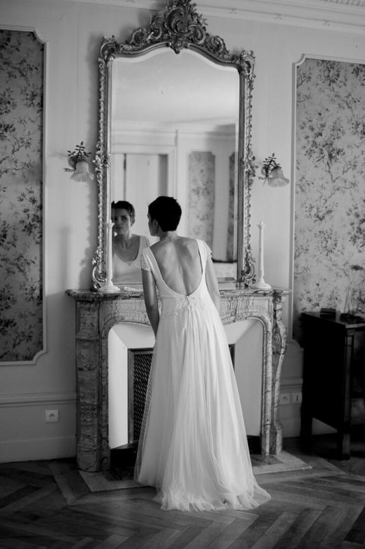 bride looking in the mirror bridal prep Louis XVI bedroom