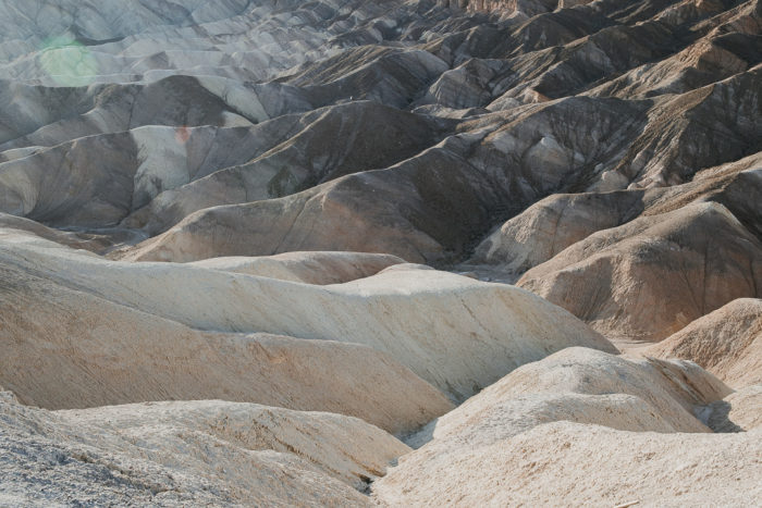 Minimal Photo of the mountains at Zabriskie Point in Death Valley National Park watching the sunset