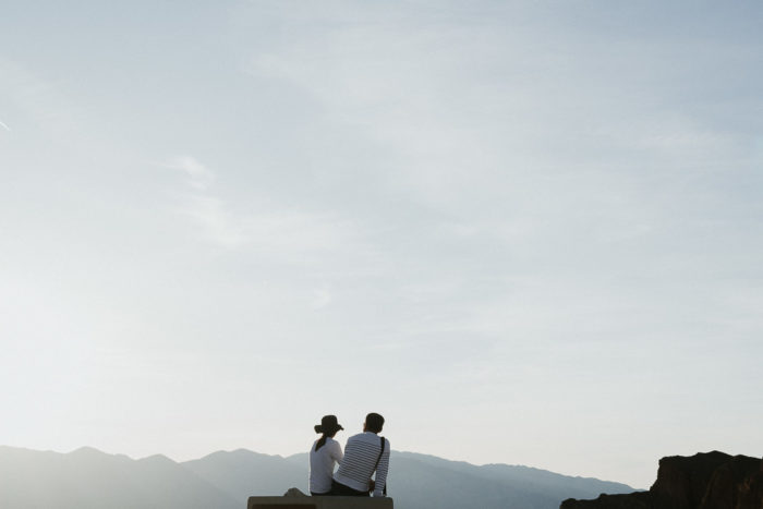 Couple watching the sunset at Zabriskie Point in Death Valley National Park