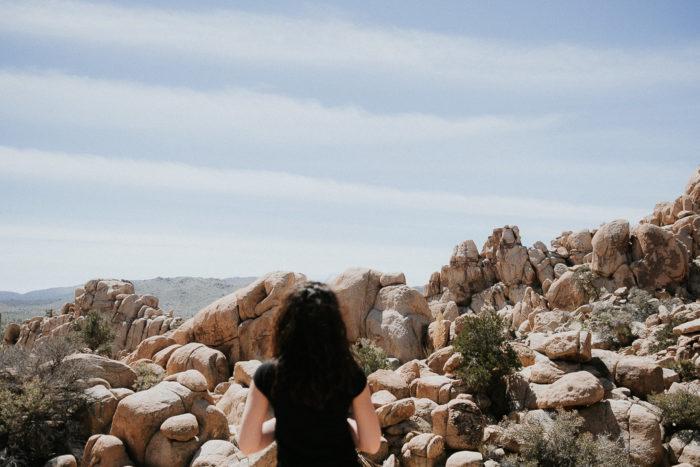 Girl standing before Hidden Valley Joshua tree National Park