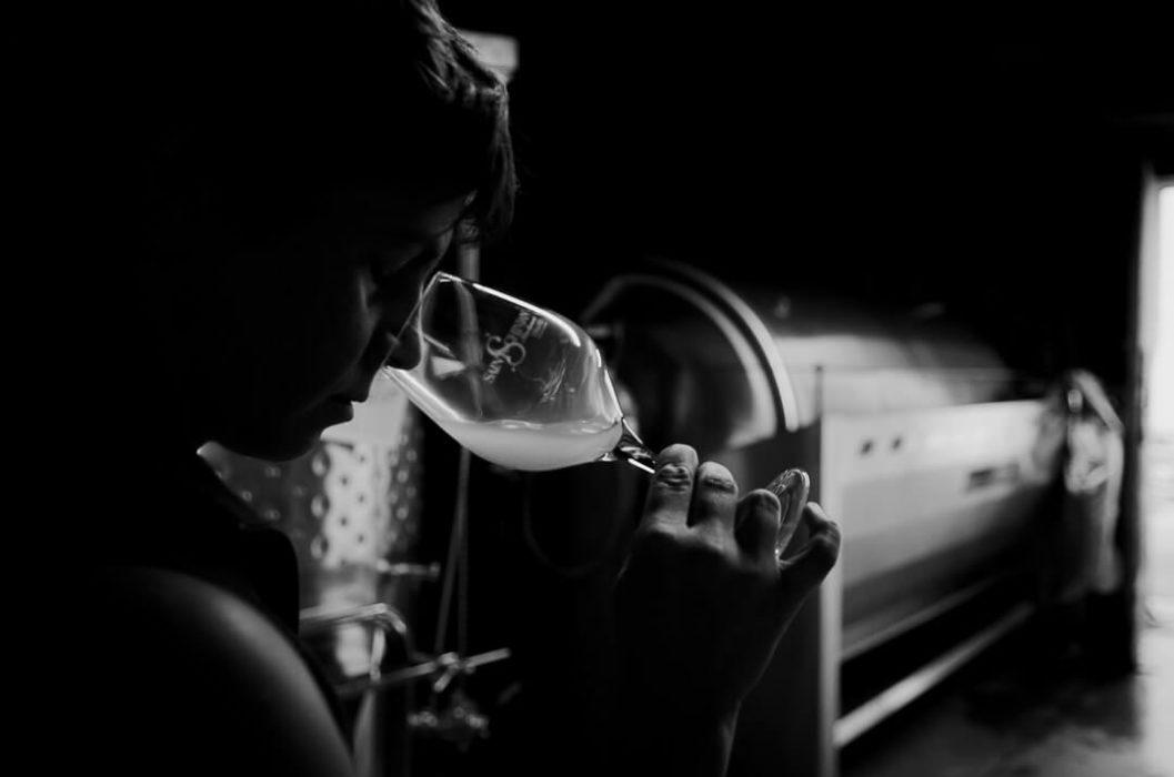 Amelie Czerwenka tatsing wine in the wine cellar