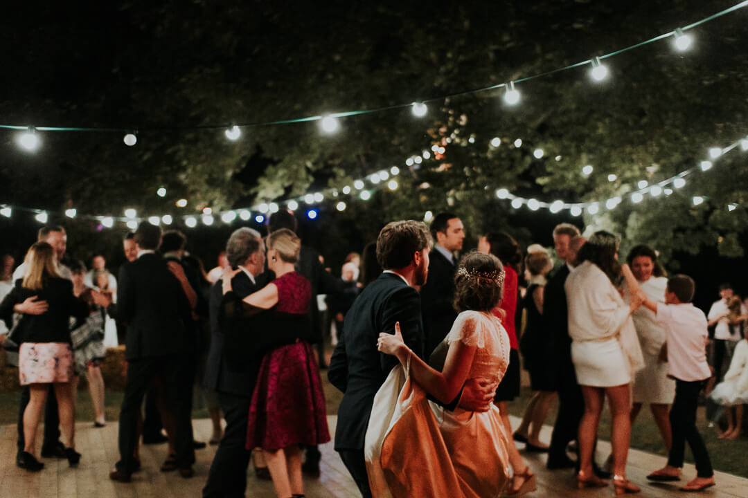 dancing at night during wedding festivities